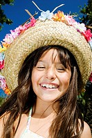 Close-up of a girl wearing a straw hat and smiling