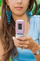 Close-up of a young woman using a mobile phone