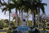 Statue surrounded by flags in a park, Bayview Park, Key West, Florida, USA