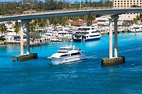 Cruise ship under a bridge in the sea, Western Bridge, Paradise Island, Bahamas