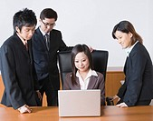 Businesspeople at laptop computer