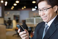 Businessman reading cell phone message
