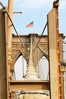 Low angle view of an American flag on a bridge, Brooklyn Bridge, New York City, New York State, USA