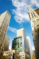 Low angle view of skyscrapers in a city, St  Patrick's Cathedral, Manhattan, New York City, New York State, USA