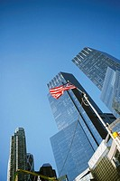 Low angle view of an American flag in front of buildings, Columbus Circle, Manhattan, New York City, New York State, USA