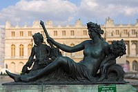 Statue in front of a palace, Palace of Versailles, Versailles, France