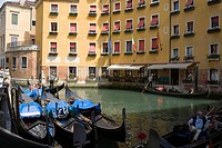 Gondolas docked in a canal near buildings, Venice, Italy