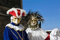 Close-up of two people wearing masquerade masks, Venice, Italy