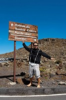 Mid adult man standing in front of an information board, Haleakala National Park, Maui, Hawaii Islands, USA