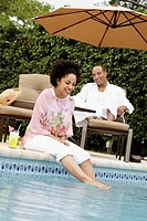 Couple laughing poolside