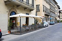 Empty chairs at a sidewalk cafe, Florence, Italy