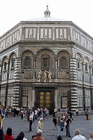 Group of people in front of a church, Battistero di San Giovanni, Florence, Italy