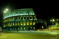 Old ruin of an amphitheater lit up at night, Coliseum, Rome, Italy