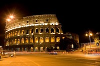 Amphitheater lit up at night, Coliseum, Rome, Italy