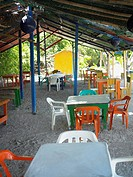 Empty tables and chairs in a restaurant, Providencia, Providencia y Santa Catalina, San Andres y Providencia Department, Colombia