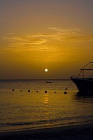 Yacht in the sea at sunset, West Bay Beach, Roatan, Bay Islands, Honduras