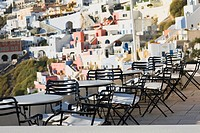 Empty chairs and tables in a restaurant, Greece