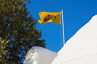Low angle view of a flag over a monastery, Monastery of the Apocalypse, Patmos, Dodecanese Islands, Greece