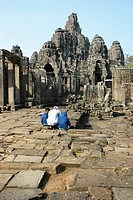 Rear view of three tourists at a temple, Angkor Wat, Siem Reap, Cambodia