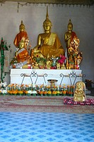 Statues of Buddha in a temple, That Luang, Vientiane, Laos