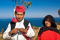 Portrait of a newlywed young couple standing, Taquile Island, Lake Titicaca, Puno, Peru
