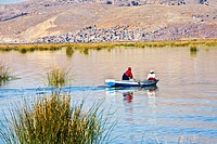 Two people rowing a boat in a lake, Lake Titicaca, Puno, Puno Region, Puno Province, Peru