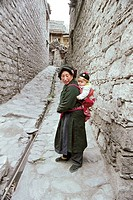 Woman with the baby on her back in Ganbao Zang minority village, Li County, Aba State, Sichuan Province of People´s Republic of China, FOR EDITORIAL U...