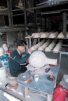 Worker painting ceramic vase in ancient kiln workshop, Jingde Town, Jiangxi Province of People´s Republic of China, FOR EDITORIAL USE ONLY