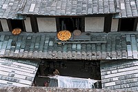Elevated view of dried maize corns on roof, Building frame of Great Lin places, Great Honglin Places, Mingqing County, Fujian Province of People's Rep...