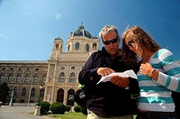 Couple checking the map outside the Kunsthistorische Museum  (Art History Museum), Vienna, Austria
