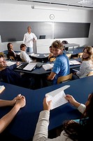 Teacher teaching students in the classroom