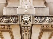 USA, New York, close-up of marble carved lions head on facade of chamber of commerce building