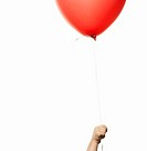 Child 2-3 holding red balloon, close-up of hand