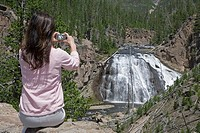 USA, Wyoming, Yellowstone National Park, woman taking photo