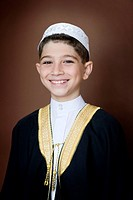 Young muslim boy 10-11 wearing traditional costume, smiling