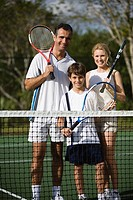 Smiling family at tennis court