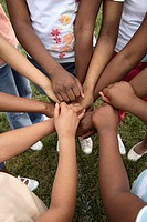 Group of girls 8-14 joining hands, close-up