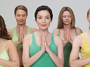 Five mature women performing yoga exercises