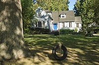 Tyre swing in front of suburban house