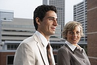 Businesswoman and businessman outdoors differential focus
