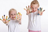 Two blond girls with paint on their fingers