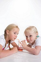 Two blond girls drinking lemonade with a straw (thumbnail)