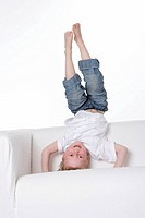 Boy standing in a headstand on a bench (thumbnail)