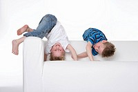 Two boys climbing on a bench (thumbnail)