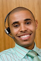 Businessman wearing headset, smiling, portrait, close-up