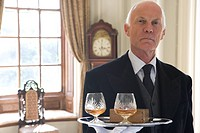 Butler with tray of drinks, portrait, close-up (thumbnail)