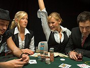 Happy woman at poker game