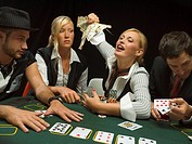 Happy woman winning at poker game
