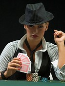 Portrait of woman in hat at poker game