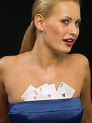 Woman with playing cards in bosom